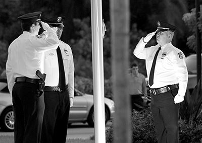 Police officers saluting